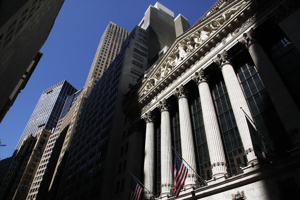 Photo - FILE - This July 15, 2013 file photo shows the New York Stock Exchange, in New York. World stock markets struggled Friday June 20, 2014as the euphoria faded from the Fed's promises of prolonged low rates to boost growth. (AP Photo/Mark Lennihan, File)