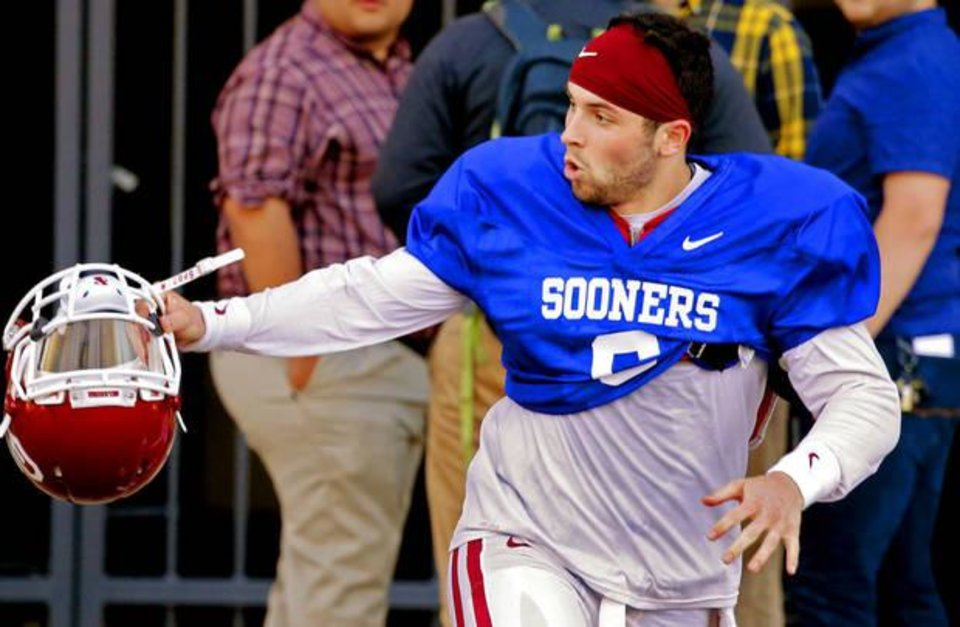 Photo - Baker Mayfield (6) leaves practice and scrambles to avoid traffic on Jenkins Ave. as the University of Oklahoma Sooners (OU) finish their first spring workout at Gaylord Family-Oklahoma Memorial Stadium in Norman, Okla., on Tuesday, March 8, 2016. Photo by Steve Sisney, The Oklahoman