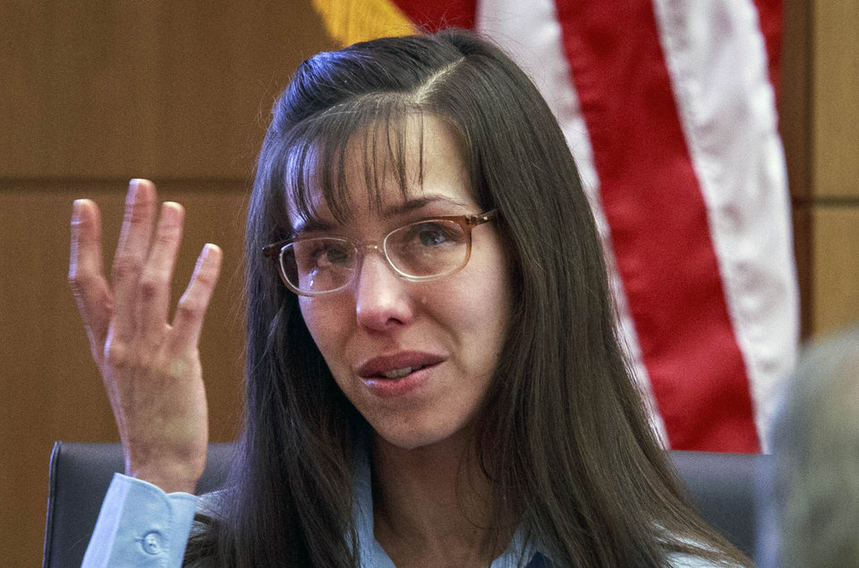 Defendant Jodi Arias tries to maintain composure as she testifies about killing Travis Alexander in 2008 during her murder trial at Judge Sherry Stephens\' Maricopa County Superior Court in Phoenix on Wednesday, Feb. 20, 2013. Arias is charged in the 2008 stabbing and shooting death of her lover, Alexander. She faces the death penalty if convicted of first-degree murder. (AP Photo/The Arizona Republic, Charlie Leight, Pool)