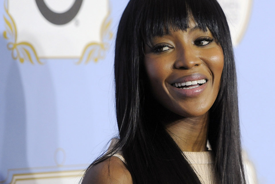 Photo - Model Naomi Campbell looks down the red carpet at the 6th Annual Black Women in Hollywood Luncheon at the Beverly Hills Hotel on Thursday, Feb. 21, 2013 in Los Angeles. (Photo by Chris Pizzello/Invision/AP)
