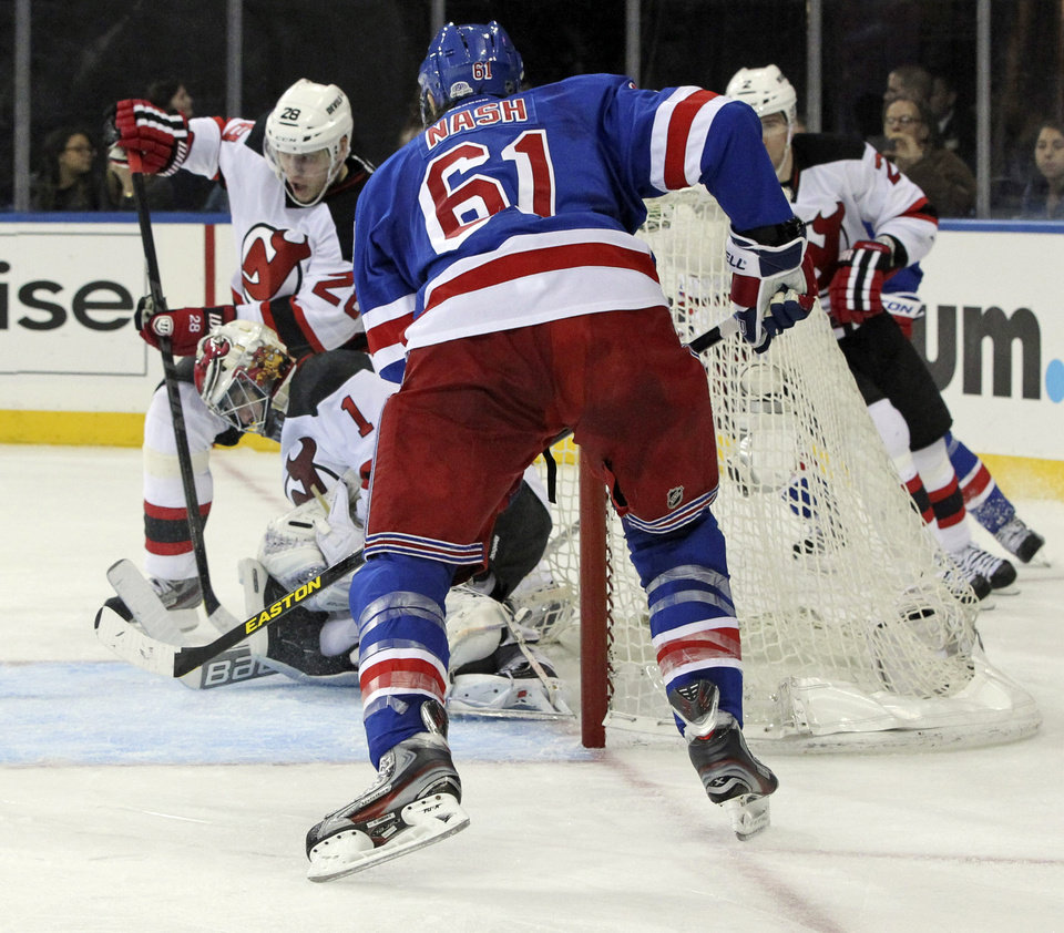 New York Rangers' Rick Nash (61) scores a goal during the second period of anhe NHL hockey game against the New Jersey Devils, Saturday, April 27, 2013 at Madison Square Garden in New York.  (AP Photo/Mary Altaffer)