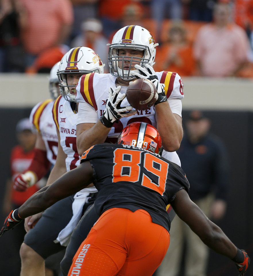 Photo - Iowa State's Dylan Soehner (89) can not hang on to the ball as Oklahoma State's Tralund Webber (89) defends on the last play of the game during a college football game between the Oklahoma State University Cowboys (OSU) and the Iowa State University at Boone Pickens Stadium in Stillwater, Okla., Saturday, Oct. 8, 2016. Photo by Sarah Phipps, The Oklahoman
