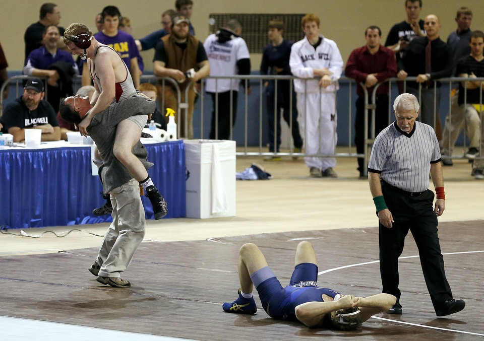 Photo - Barnsdall's Ethan Walker celebrates after beating Heritage Hall's Caleb Hawes after the Class 3A 195-pound championship match in the state wrestling championships at the State Fair Arena in Oklahoma City, Saturday, Feb. 23, 2013. Photo by Bryan Terry, The Oklahoman
