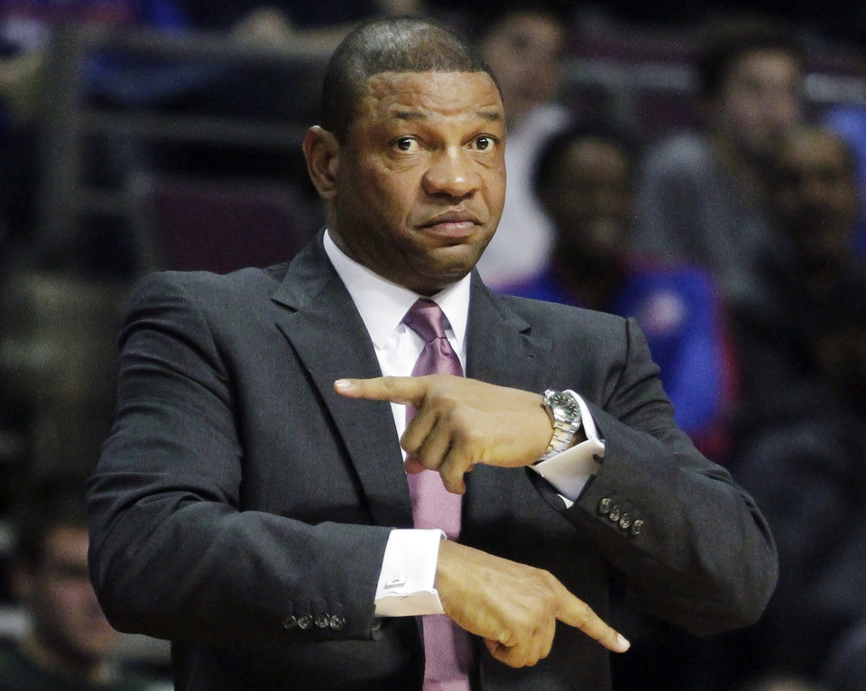Photo - FILE - In this Nov. 18, 2012 file photo, Boston Celtics coach Doc Rivers gestures for a traveling call against the Detroit Pistons in the first half of an NBA basketball game in Auburn Hills, Mich. Rivers will be the next coach of the Los Angeles Clippers if the NBA approves the rare but not unprecedented trade of an active coach, a Boston Celtics official told The Associated Press on Sunday night, June 23, 2013. (AP Photo/Duane Burleson, File)