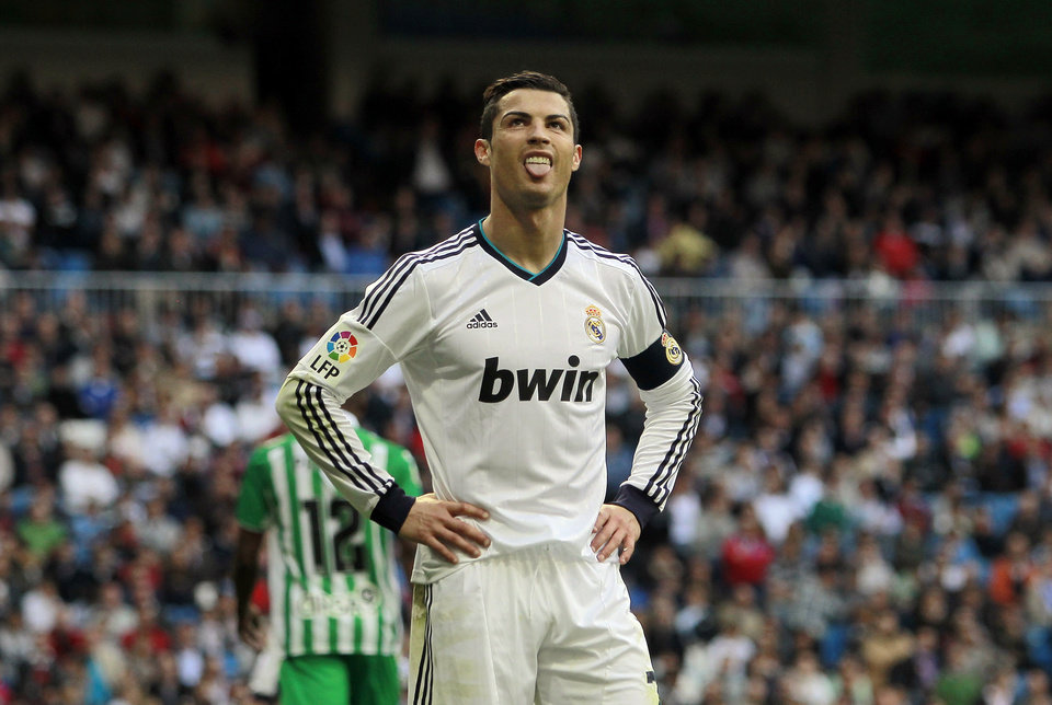 Photo - Real Madrid's Cristiano Ronaldo from Portugal reacts during a Spanish La Liga soccer match against Betis at the Santiago Bernabeu stadium in Madrid, Spain, Saturday, April 20, 2013. (AP Photo/Andres Kudacki)