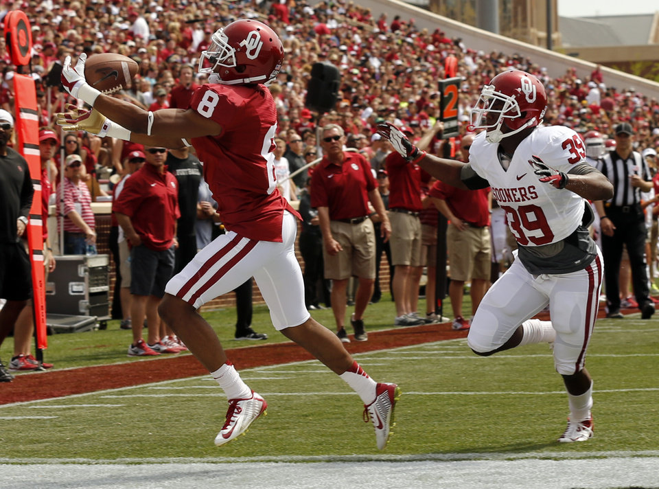 Photo - Austin Bennett (8) catches a touchdown pass in front of Darius Owens (39) during the Spring College Football Game of the University of Oklahoma Sooners (OU) at Gaylord Family-Oklahoma Memorial Stadium in Norman, Okla., on Saturday, April 12, 2014.  Photo by Steve Sisney, The Oklahoman
