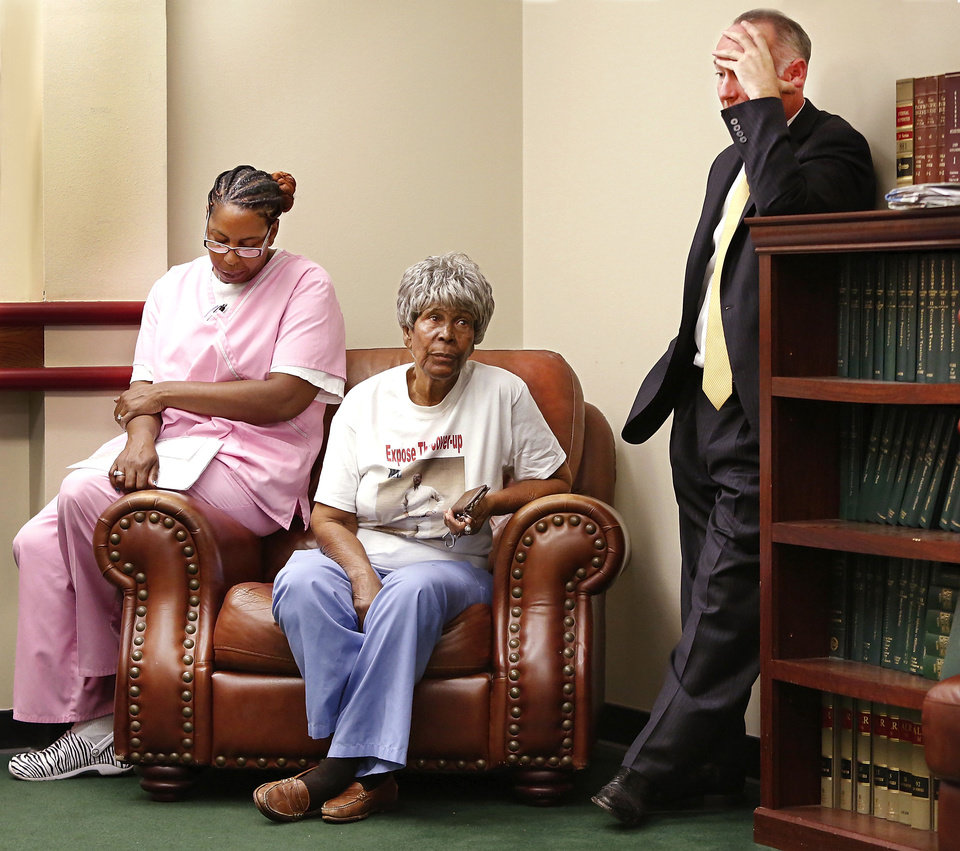 Photo - Oklahoma City attorney David Slane, right,  accompanies the mother, Lonzetta Morrison, center, a sister, Kimberly Turner, left,  and the widow, not pictured,  of Robin Howard in a lengthy meeting with District Attorney David Prater in his office Wednesday afternoon, Oct. 17, 2012.  This photo shows them waiting to be taken back to Prater's office. Prater told them he had decided not to file charges in the death of Howard, who died after being arrested by Oklahoma City police. The medical examiner ruled Howard's death to be a homicide. Howard's family is accusing the police department of covering up details about his death.      Photo by Jim Beckel, The Oklahoman