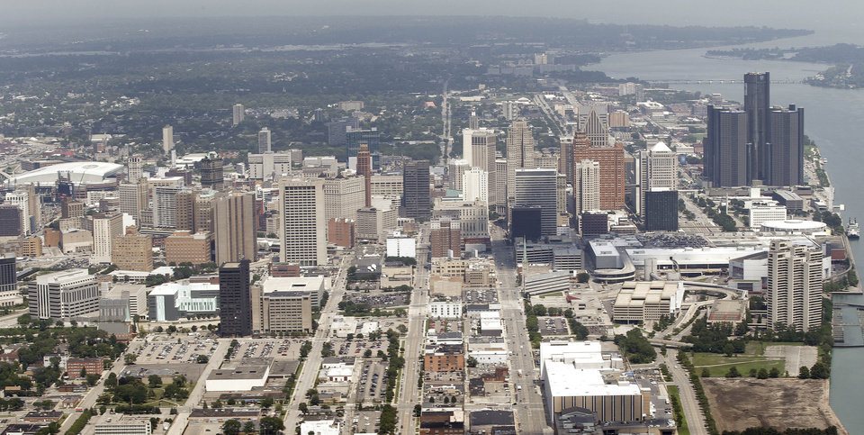 Photo - FILE - In this July 17, 2013 file aerial photo is the city of Detroit. The once-mighty industrial giant that put the world on wheels, which was about to default on a good chunk of a long-term debt exceeding $18 billion, now is getting a second chance in a federal bankruptcy court-led restructuring. (AP Photo/Paul Sancya)