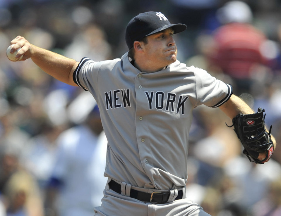 Photo - New York Yankees starter Chase Whitley delivers a pitch during the first inning of an interleague baseball game against the Chicago Cubs in Chicago, May 21, 2014. (AP Photo/Paul Beaty)