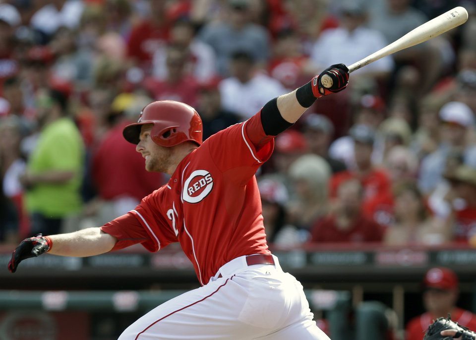 Photo - Cincinnati Reds' Zack Cozart hits a double off Philadelphia Phillies starting pitcher Roberto Hernandez to drive in a run in the fourth inning of a baseball game, Saturday, June 7, 2014, in Cincinnati. (AP Photo/Al Behrman)