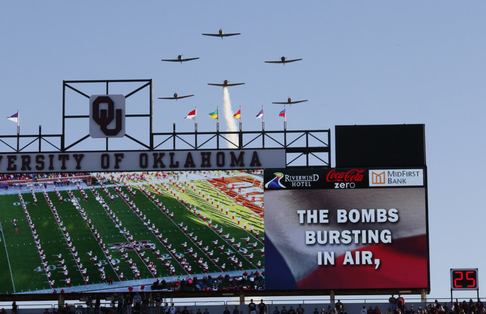 Warbirds fly their vintage airplanes during the pre game of a college football game between the University of Oklahoma Sooners (OU) and the TCU Horned Frogs at Gaylord Family-Oklahoma Memorial Stadium in Norman, Okla., on Saturday, Oct. 5, 2013. Photo by Steve Sisney, The Oklahoman
