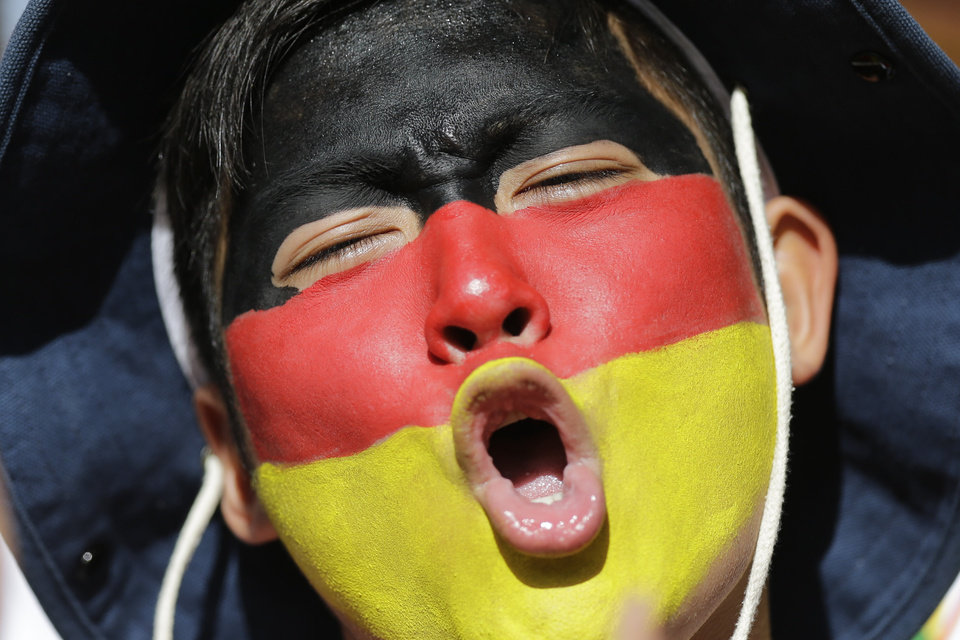 Photo - A fan with his face painted with the colors of the German flag cheers before the start of the World Cup final soccer match between Germany and Argentina at Maracana Stadium in Rio de Janeiro, Brazil, Sunday, July 13, 2014. (AP Photo/Victor R. Caivano)