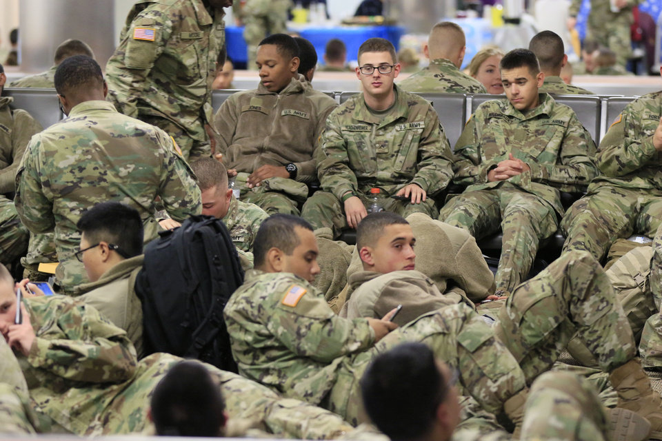 Photo - Soldiers from Ft. Sill gather at Will Rogers World Airport in Oklahoma City, Okla. on their way home for Christmas, Monday, Dec. 19, 2016.  Photo by Paul Hellstern, The Oklahoman