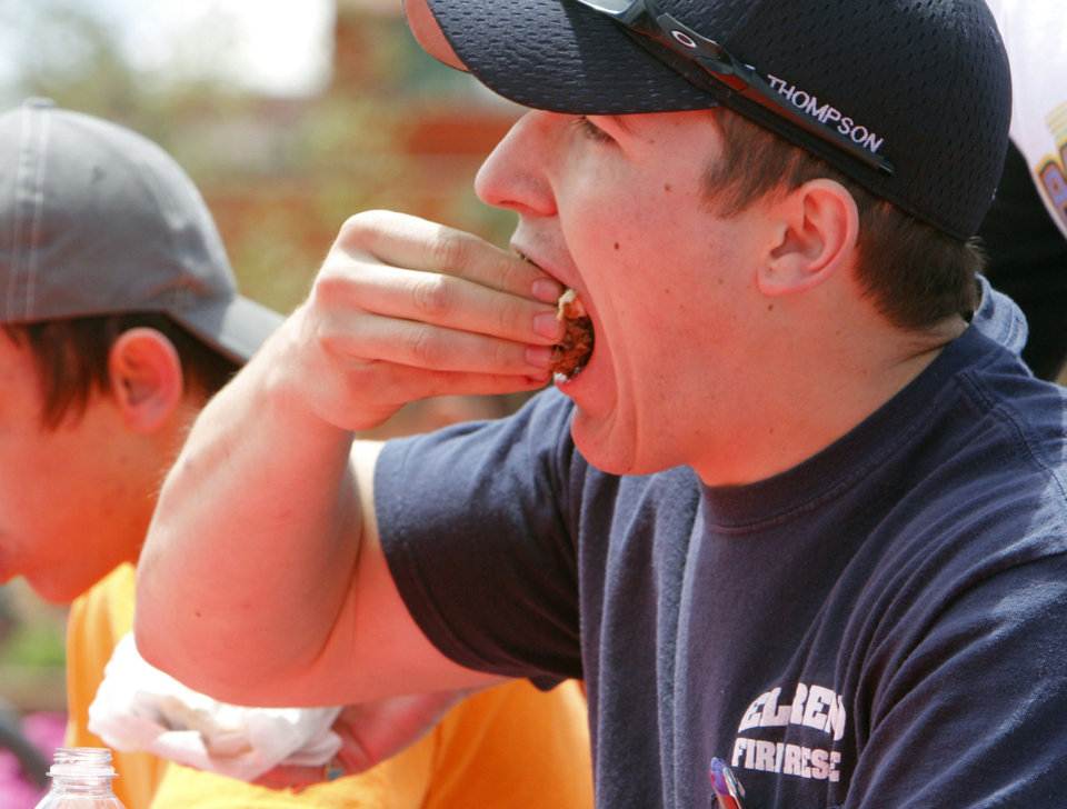 El Reno firefighter Terrel Thompson competes in the burger eating competition during the Fabulous Burger Day Festival in El Reno, OK, Saturday, May 4, 2013. He won the event after eating 10 hamburgers in 10 minutes.  By Paul Hellstern, The Oklahoman