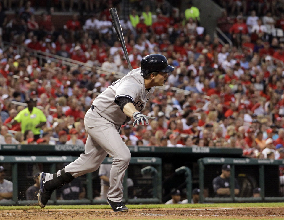 Photo - New York Yankees' John Ryan Murphy watches his two-run single during the third inning of a baseball game against the St. Louis Cardinals on Wednesday, May 28, 2014, in St. Louis. (AP Photo/Jeff Roberson)