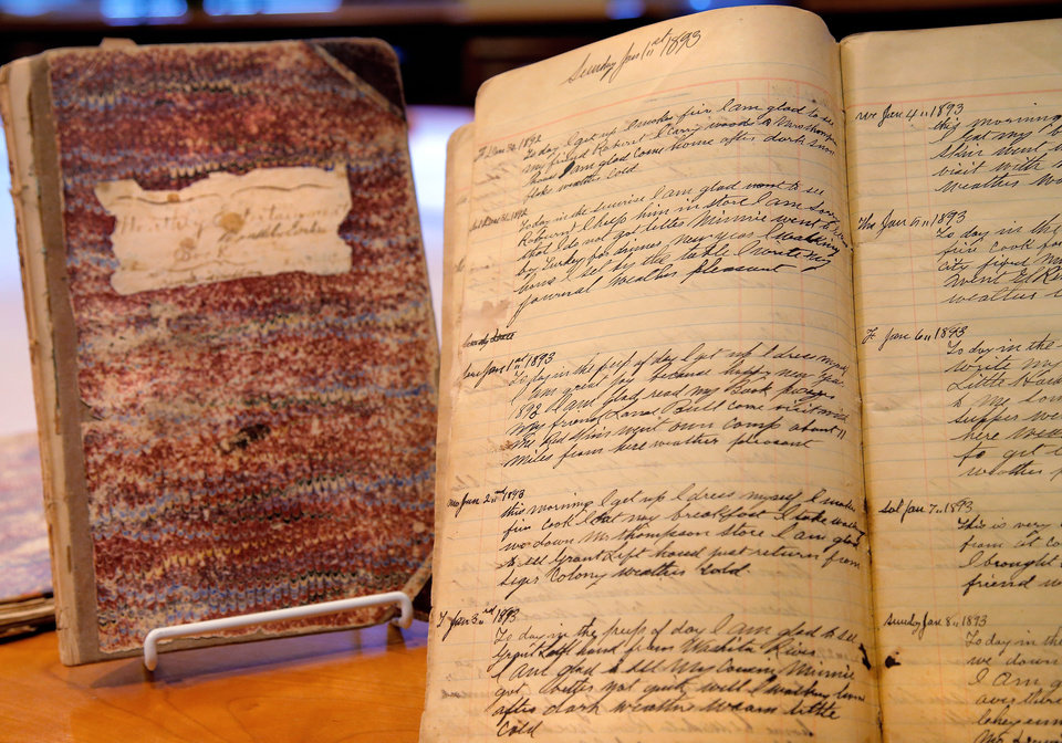Photo -  One of the handwritten journals belonging to the Rev. David Pendleton Oakerhater that recently were donated to the center by Oakerhater's great-great-granddaughter. [Photo by Jim Beckel, The Oklahoman]