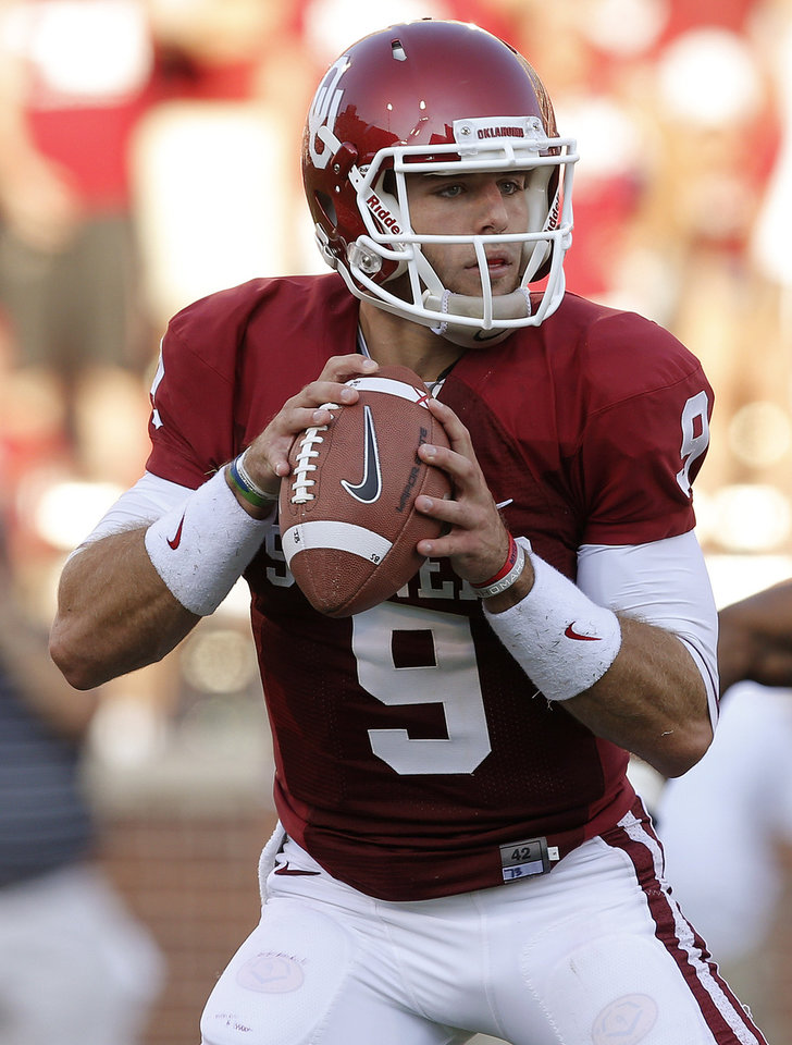 Photo - Oklahoma's Trevor Knight (9) drops back to pass during a college football game between the University of Oklahoma Sooners (OU) and the University of Louisiana Monroe Warhawks at Gaylord Family-Oklahoma Memorial Stadium in Norman, Okla., on Saturday, Aug. 31, 2013. Photo by Bryan Terry The Oklahoman
