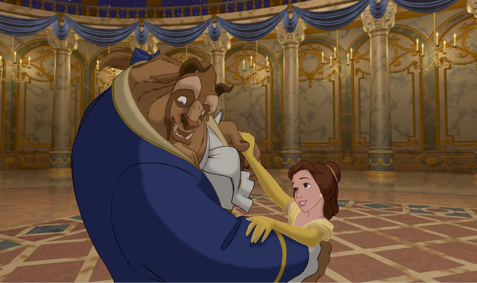 Photo -  The Beast and Belle share a dance in