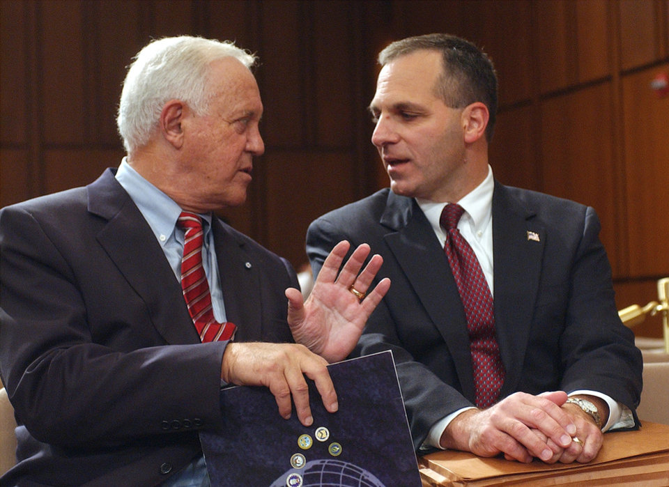 Photo -   FILE - This Oct. 8, 2002 file photo shows former New Hampshire Sen. Warren Rudman, left, talking with former FBI Director Louis Freeh on Capitol Hill in Washington. Rudman, who co-authored a ground-breaking budget balancing law, championed ethics and led a commission that predicted the danger of homeland terrorist attacks before 9/11, has died. He was 82. (AP Photo/Dennis Cook, File)