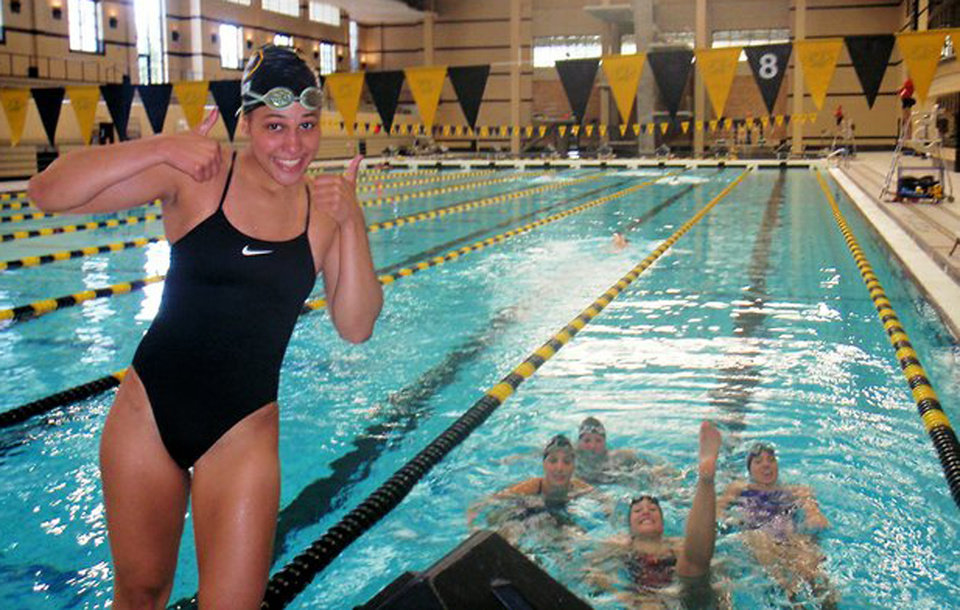 Photo - In this photo provided by Mike Menu is his daughter, Sasha Menu Courey, with teammates. The Canadian family of former University of Missouri school swimmer says the school and its athletics department failed to properly investigate her alleged off-campus rape by as many as three football players in 2010. Menu Courey struggled with mental illness and committed suicide 16 months later. (AP Photo/Courtesy Mike Menu)