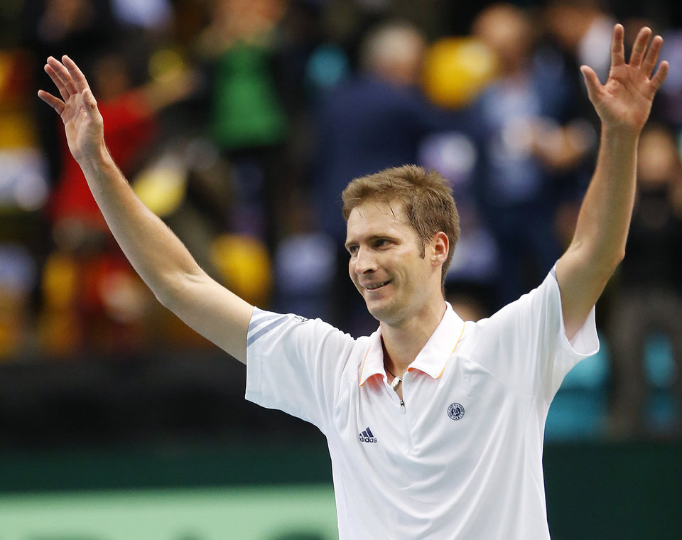 Photo - Germany's Florian Mayer celebrates after beating Spain's Feliciano Lopez during a Davis Cup World Group first round tennis match between Germany and Spain in Frankfurt, Germany, Friday, Jan. 31, 2014. (AP Photo/Michael Probst)
