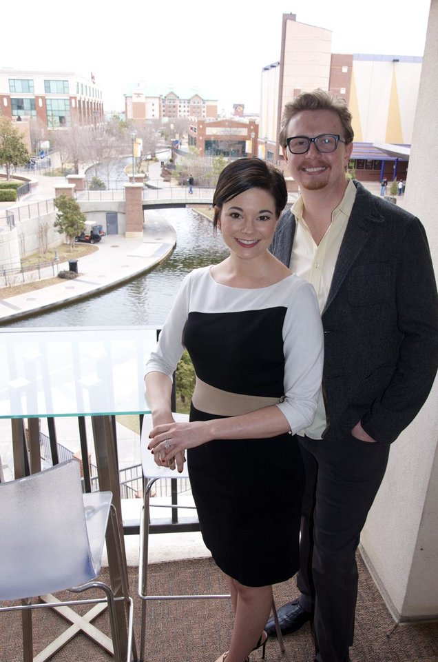 Photo -  Jennifer and J.D. Upton have a view of the Bricktown Canal from the balcony of their condo at Centennial Lofts at Bricktown, 200 S Oklahoma Ave.        Jackson Fall  -  The Oklahoman