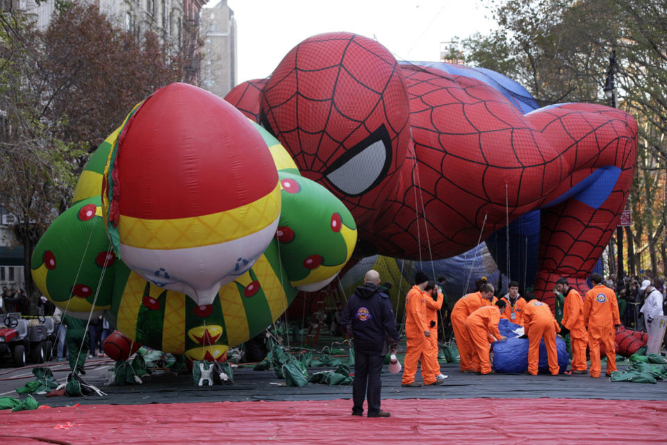 Photo -   The Chloe ballon and Spider-Man balloon are inflated for the 86th annual Macy's Thanksgiving Day Parade on New York's Upper West Side, Wednesday, Nov. 21, 2012. More than 3 million people typically attend the event and it has a TV audience of 50 million. (AP Photo/Richard Drew)