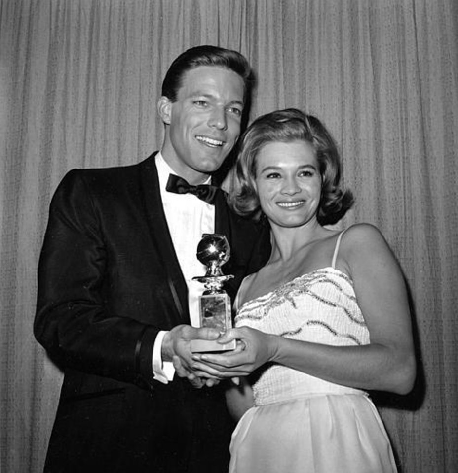 Actor Richard Chamberlain, left, and actress Angie Dickinson pose at the annual Golden Globe Awards of the Hollywood Foreign Press Association in Los Angeles, Ca., March 5, 1963.  (AP Photo)