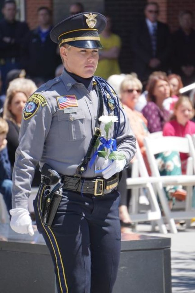 Photo -  Autumn Sheets, a member of the Oklahoma City Police Department's Honor Guard, at the Oklahoma City Police Memorial Service on Friday. [Josh Wallace/The Oklahoman]
