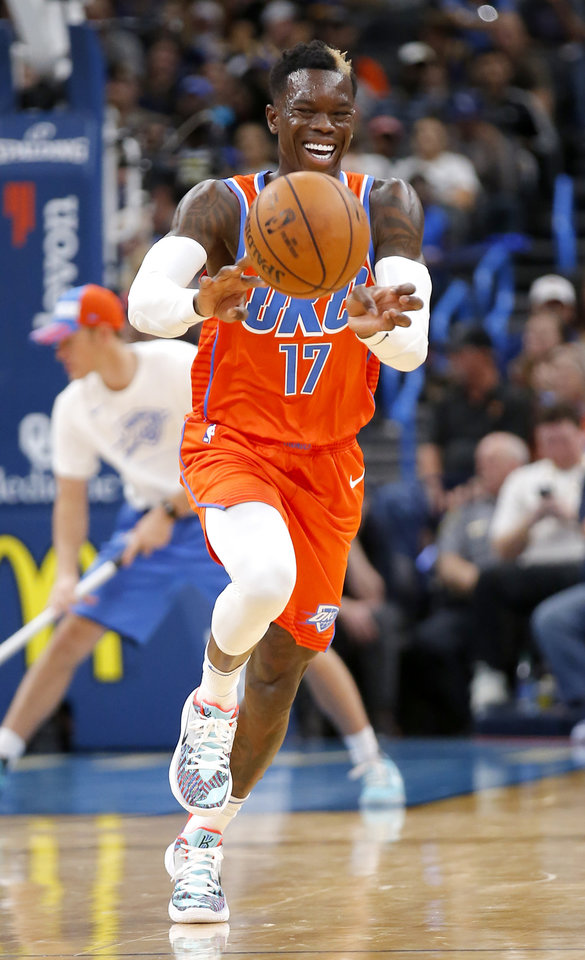 Photo - Oklahoma City's Dennis Schroder (17) passes the ball up court during the NBA game between the Oklahoma City Thunder and Golden State Warriors at Chesapeake Energy Arena,  Sunday, Oct. 27, 2019. Thunder won 120-92.[Sarah Phipps/The Oklahoman]