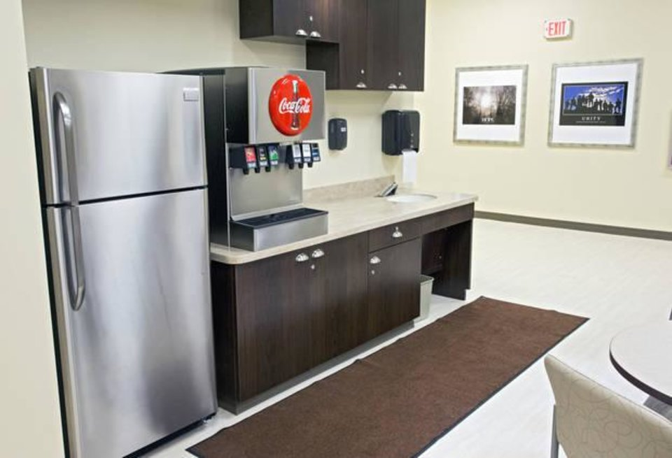 Photo -  The commons area includes a refrigerator and soft drink fountain at Oakwood Springs' behavioral health unit. [Photo by Chris Landsberger, The Oklahoman]