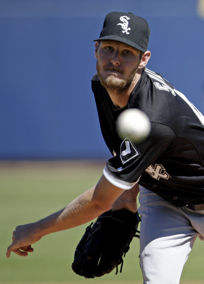 Photo - Chicago White Sox's Chris Sale throws before the first inning of an exhibition spring training baseball game against the Milwaukee Brewers Monday, March 10, 2014, in Phoenix. (AP Photo/Morry Gash)