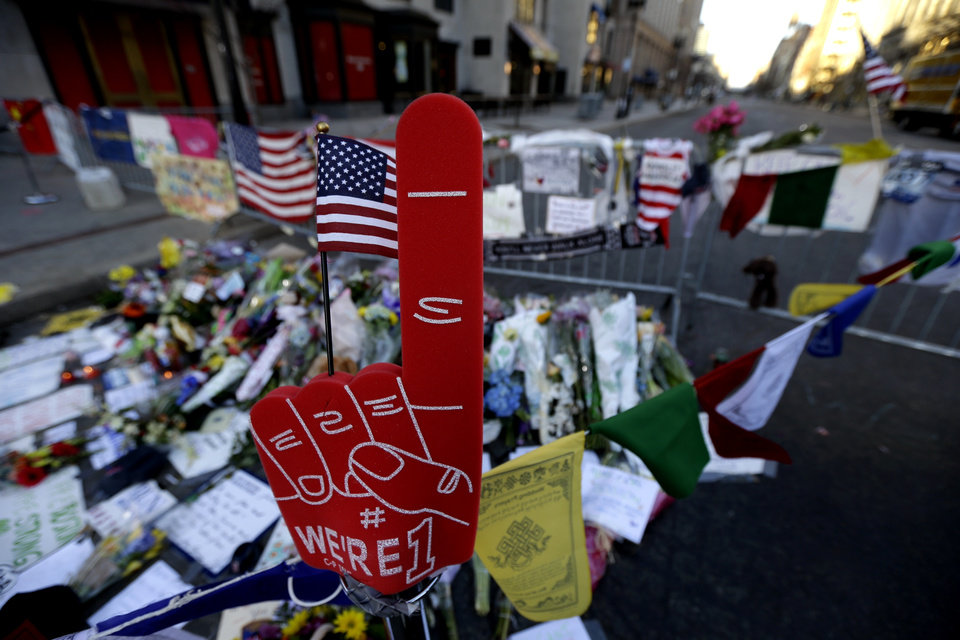 A foam finger stands at a makeshift memorial on Boylston Street in Boston, near the blast site of the Boston Marathon explosions, Thursday, April 18, 2013. The city continues to cope following Monday's explosions near the finish line of the marathon. (AP Photo/Julio Cortez)