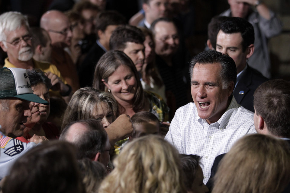 Photo -   Republican presidential candidate, former Massachusetts Gov. Mitt Romney greets supporters at a campaign stop in Pittsburgh, Pa., Friday, May 4, 2012. (AP Photo/Jae C. Hong)
