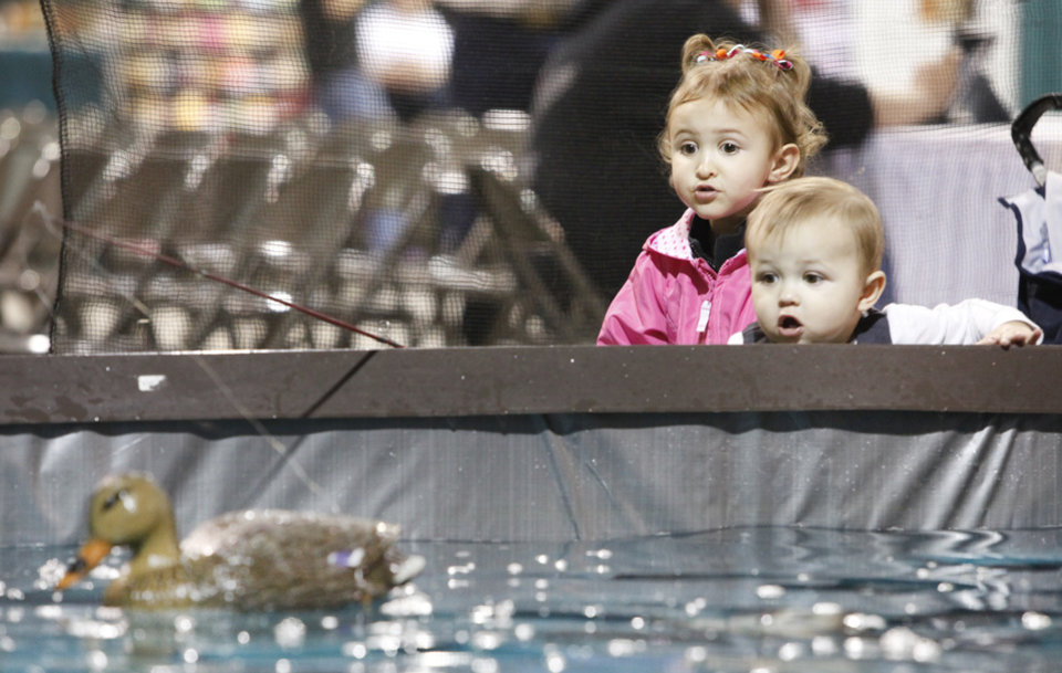 Jacey Blanford, 3, and her little brother 17-month-old Weston Blanford look at a duck decoy as they fish for catfish at the Backwoods Hunting & Fishing Expo at State Fair Park in Oklahoma City, February  25 , 2011. Photo by Steve Gooch, The Oklahoman