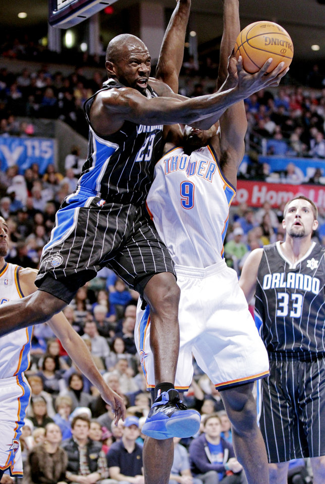 Orlando Magic's Jason Richardson (23) drives past Oklahoma City Thunder's Serge Ibaka (9) in the first half as the Oklahoma City Thunder play the Orlando Magic in NBA basketball at the Chesapeake Energy Arena on Sunday, Dec. 25, 2011, in Oklahoma City, Okla.  Photo by Steve Sisney, The Oklahoman