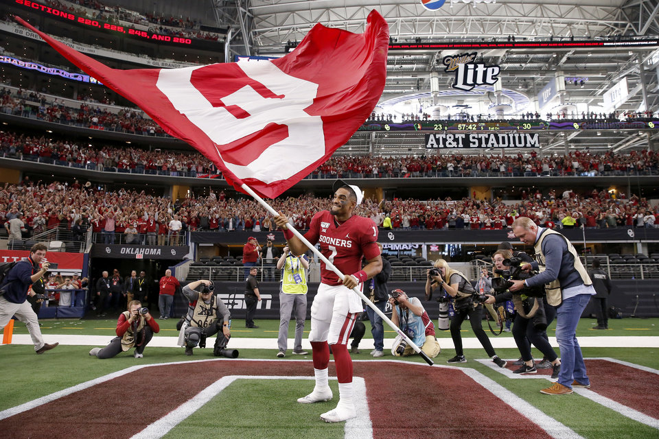 Photo - Oklahoma's Jalen Hurts (1) celebrates after the Big 12 Championship Game between the University of Oklahoma Sooners (OU) and the Baylor University Bears at AT&T Stadium in Arlington, Texas, Saturday, Dec. 7, 2019. Oklahoma won 30-23. [Bryan Terry/The Oklahoman]