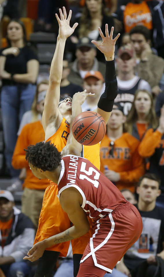 Photo - Oklahoma's Alondes Williams (15) hits Oklahoma State's Lindy Waters III (21) as he reaches for the ball during an NCAA men's Bedlam basketball game between the Oklahoma State University Cowboys (OSU) and the University of Oklahoma Sooners (OU) at Gallagher-Iba Arena in Stillwater, Okla., Saturday, Feb. 22, 2020. [Bryan Terry/The Oklahoman]