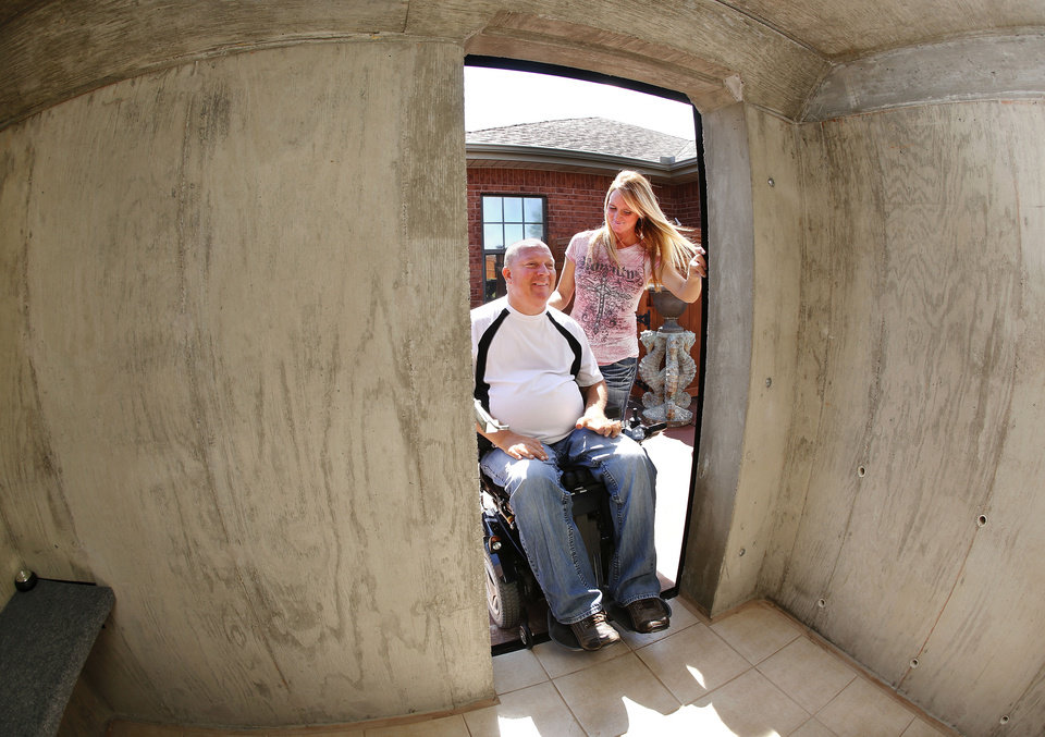 Photo - Jeff and Dawna Rodgers had an above-ground safe room installed in the back yard of their Bethel Acres home less than a week before they had to use it to shelter from a tornado that passed over them  on Sunday, May 19, 2013. Jeff has to use a wheel chair and cannot get into a below-ground storm shelter.  Jim Beckel - THE OKLAHOMAN