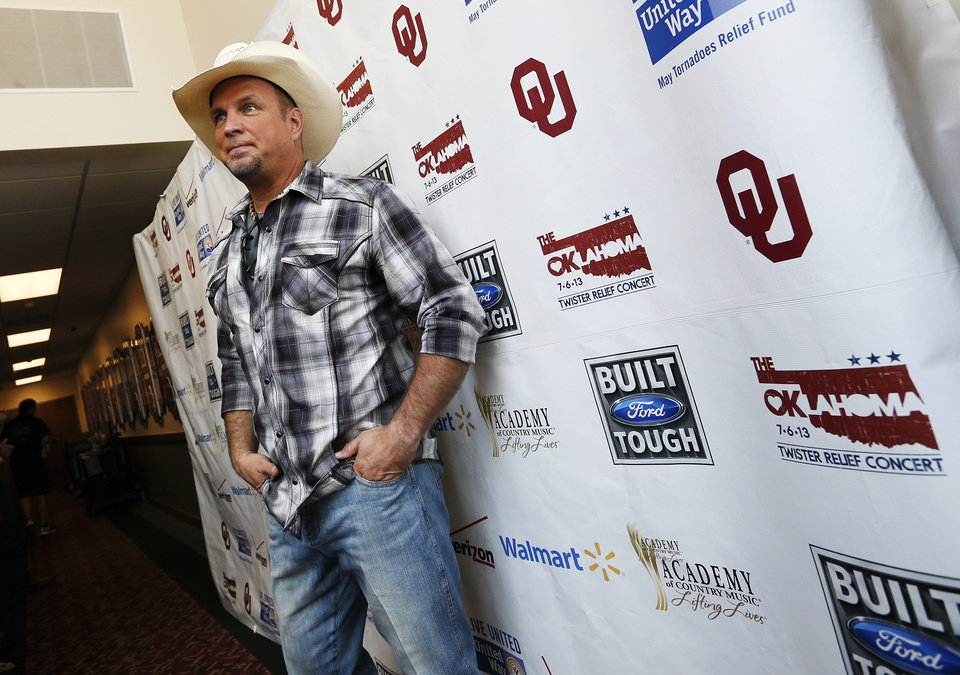 Garth Brooks poses for photographers during the Oklahoma Twister Relief Concert, benefiting victims of the May tornadoes, at Gaylord Family - Oklahoma Memorial Stadium on the campus of the University of Oklahoma in Norman, Okla., Saturday, July 6, 2013. Photo by Nate Billings, The Oklahoman