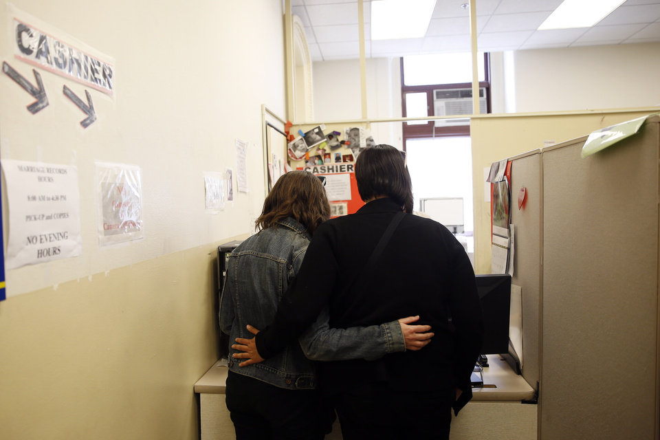 Photo - Carolyn Caton, left, and Noelle Foizen wait for their marriage license at the Philadelphia Marriage Bureau in City Hall, Tuesday, May 20, 2014, in Philadelphia. Pennsylvania's ban on gay marriage was overturned by a federal judge Tuesday. (AP Photo/Matt Slocum)