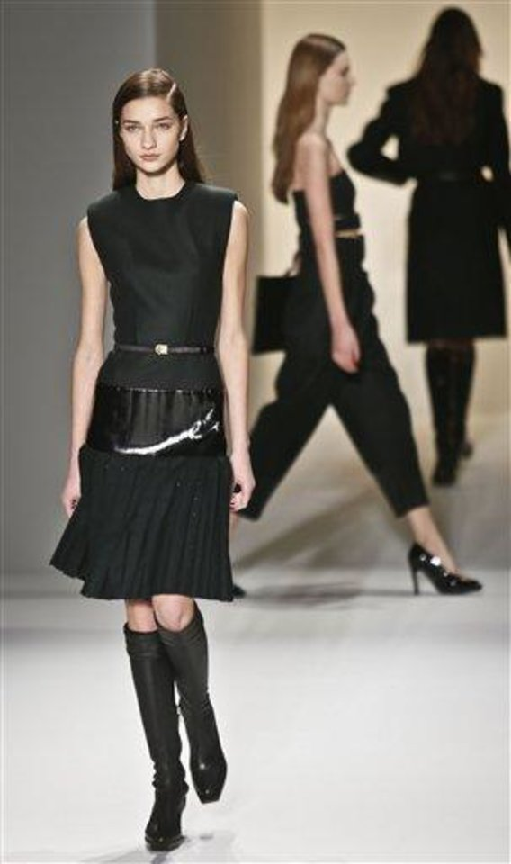 Fashion from the Fall 2013 collection of Calvin Klein is modeled on Thursday, Feb. 14, 2013 in New York. (AP Photo/Bebeto Matthews)
