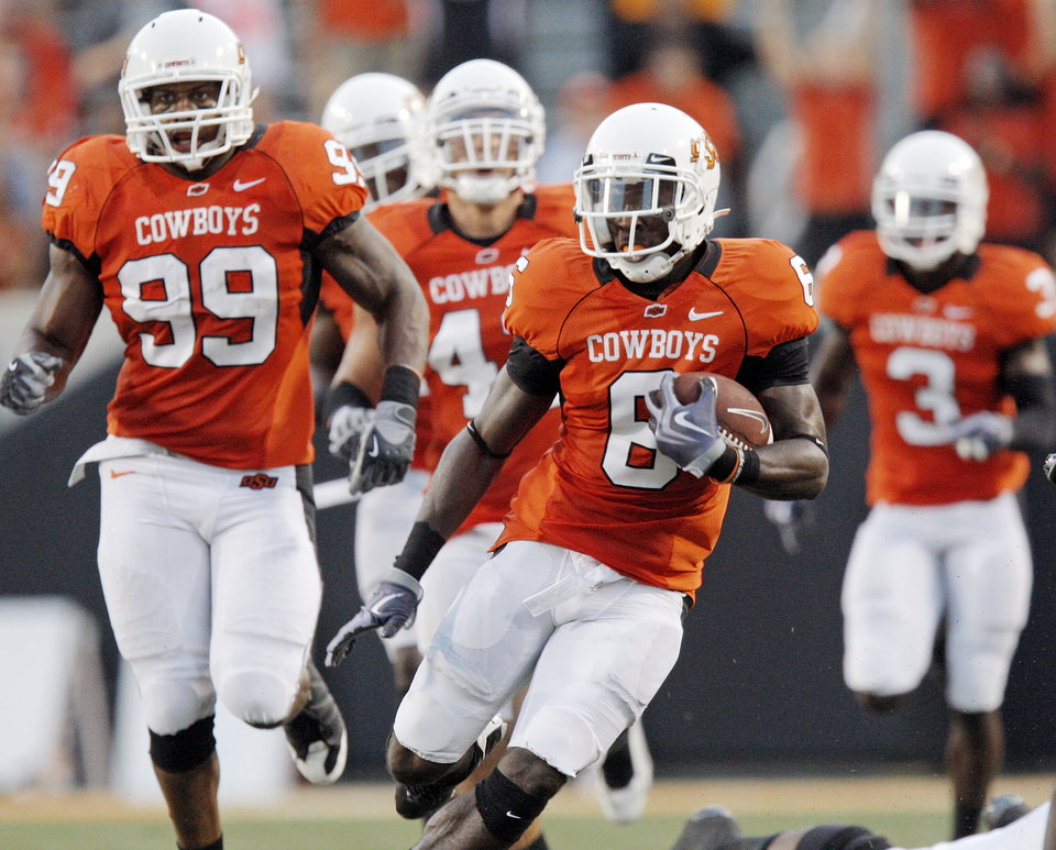 OSU\'s Andrew McGee (6) runs in front of the Cowboy defense, including Richeti Jones (99), as McGee returns an interception 79 yards in the second quarter during the college football game between the University of Tulsa (TU) and Oklahoma State University (OSU) at Boone Pickens Stadium in Stillwater, Oklahoma, Saturday, September 18, 2010. Photo by Nate Billings, The Oklahoman