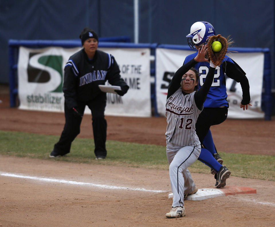 Little Axe's Cheyann Brophy (22) is safe a first past Sequoyah's Megan Towie (12) during the 3A OSSAA Championship softball game between Little Axe and Sequoyah at ASA Hall of Fame Stadium in Oklahoma City, Saturday, Oct. 6, 2012.  Photo by Garett Fisbeck, The Oklahoman