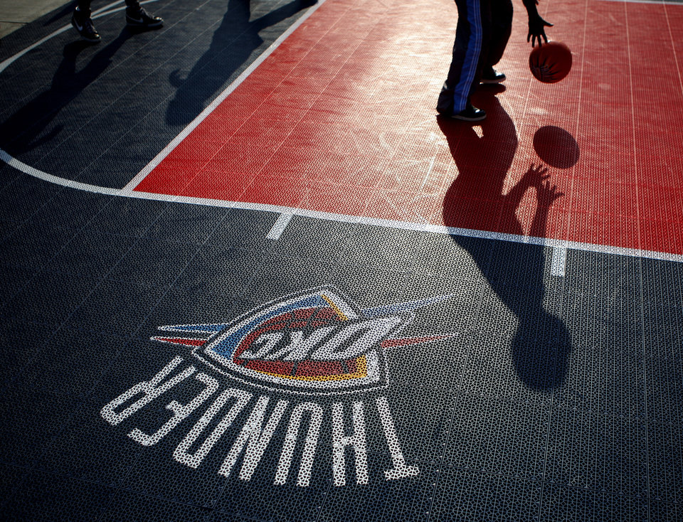Fans play basketball on a court outside the arena before the NBA basketball game between the Oklahoma City Thunder and the Los Angeles Clippers at Chesapeake Energy Arena in Oklahoma City, Wednesday, April 11, 2012. Photo by Bryan Terry, The Oklahoman