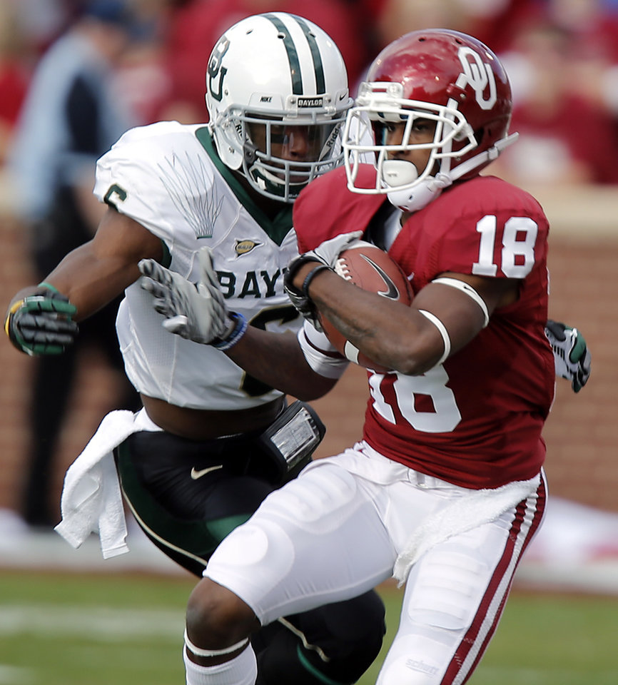 Photo - Baylor's Ahmad Dixon (6) chases down Oklahoma's Jalen Saunders (18) after a catch during the college football game between the University of Oklahoma Sooners (OU) and Baylor University Bears (BU) at Gaylord Family - Oklahoma Memorial Stadium on Saturday, Nov. 10, 2012, in Norman, Okla.  Photo by Chris Landsberger, The Oklahoman