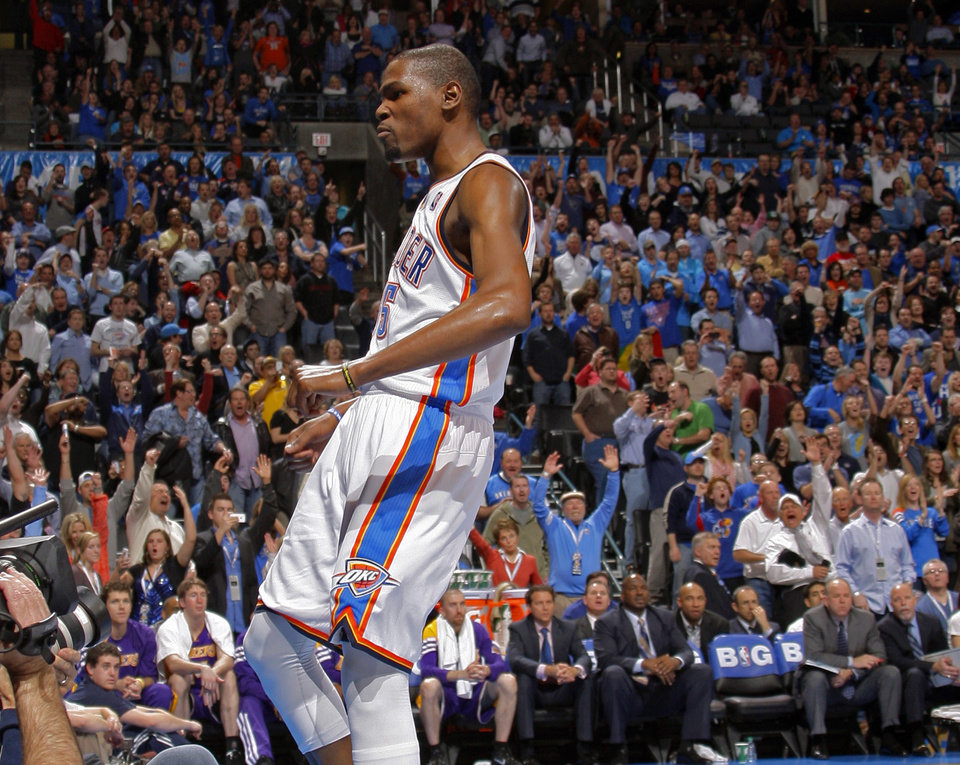 Photo - Oklahoma City's Kevin Durant (35) reacts during an NBA basketball game between the Oklahoma City Thunder and the Los Angeles Lakers at Chesapeake Energy Arena in Oklahoma City, Thursday, Feb. 23, 2012.  Oklahoma City won 100-85. Photo by Bryan Terry, The Oklahoman