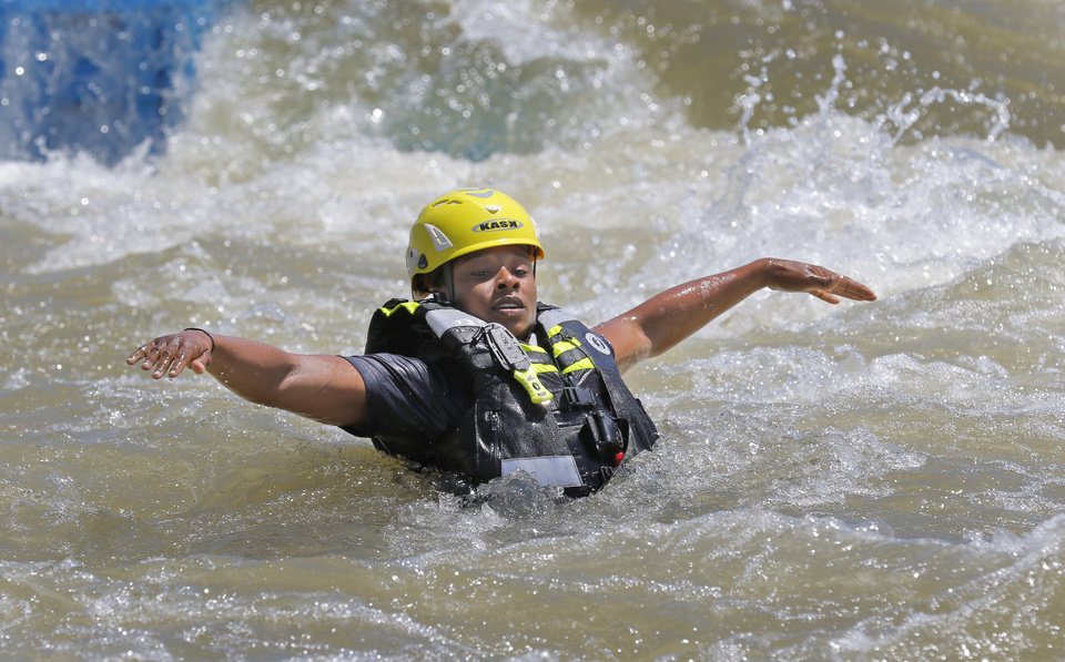 Photo -  Firefighter Evelyn Taylor floats in the water as Oklahoma City Fire Station 8 works on its swift-water rescue techniques. [Photos By Steve Gooch, The Oklahoman]