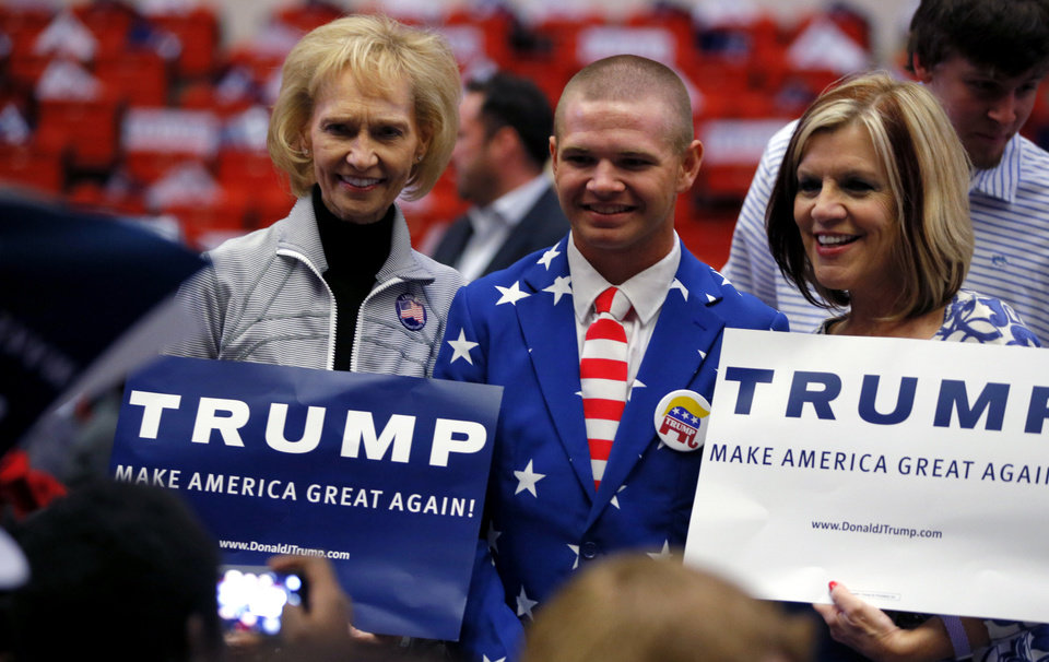 Photo - Sharon Twiehaus of Oklahoma City, left, Ethan Lang of Duncan, and Lisa Sweet of Newcastle pose for a photo vefore a rally for Republican presidential candidate Donald Trump at the Cox Convention Center in Oklahoma City, Friday, Feb. 26, 2016. Photo by Bryan Terry, The Oklahoman