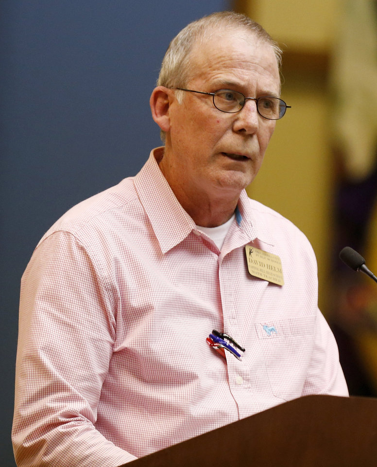 Photo -  Capitol Hill math teacher David Helm addresses the Oklahoma City School Board about his concerns with the process to change the Capitol Hill High School mascot's name.    NATE BILLINGS -  NATE BILLINGS